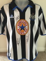 Multi signed Newcastle retro shirt