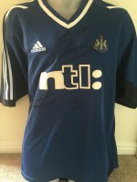 Multi signed Newcastle away shirt