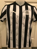 Multi signed Newcastle 17/18 home shirt